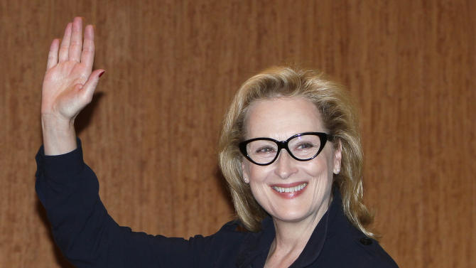 """FILE - In this March 7, 2012 file photo, Academy Award winning actress Meryl Streep waves during a press conference to promote their movie """"The Iron Lady""""  in Tokyo, Japan. Kevin Kline will play Romeo opposite Meryl Streep's Juliet for a one-night-only staged reading of Shakespeare's play in Central Park. The Public Theater said Tuesday that Streep and Kline will combine on June 18 to help celebrate the 50th anniversary of its Shakespeare in the Park series. (AP Photo/Shizuo Kambayashi, file)"""
