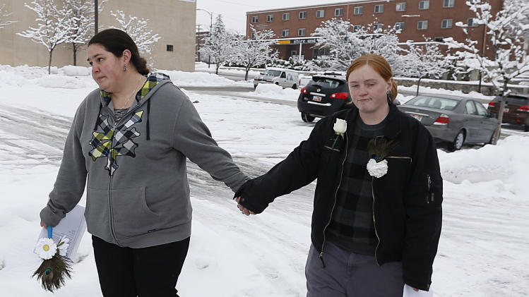 Jessica Chavez, left, and her partner, Alecia Conder, walk through the snow as they leave the Ogden clerk and auditor's office after it had canceled its special Saturday opening to issue marriage licenses in Ogden, Utah, Saturday, Dec. 21, 2013. A federal judge on Friday, struck down Utah's ban on same-sex marriage saying the law violates the U.S. Constitution. (AP photo/George Frey)