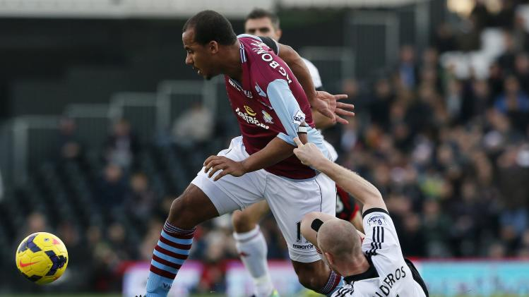 Fulham's Senderos challenges Aston Villa's Agbonlahor during their English Premier League soccer match in London