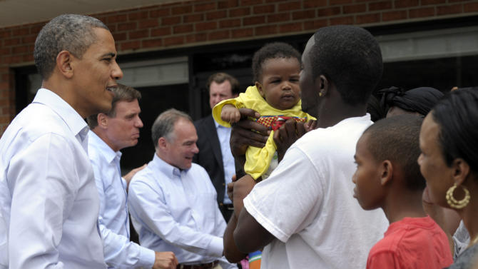 President Barack Obama talks with Kerry Christophe, Jr., who holds his son Kerry Christophe III during a stop at Rick's Cafe in Virginia Beach, Va., Friday, July 13, 2012. Obama is accompanied by Sen. Mark Warner, D-Va., is second from left and Virginia Democratic Senate candidate, former Gov. Tim Kaine, third from left.  (AP Photo/Susan Walsh)