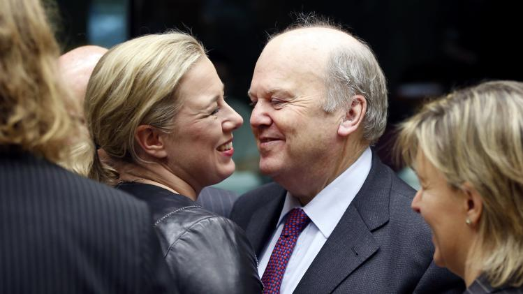 Finland's Finance Minister Urpilainen greets her Irish counterpart Noonan during a EU finance ministers meeting in Brussels