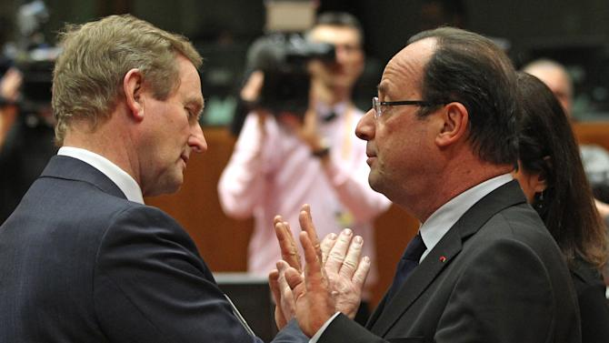 French President Francois Hollande, right, talks with Irish Prime Minister Enda Kenny, during the EU Budget summit at the European Council building in Brussels, Thursday, Feb. 7, 2013. European Union leaders drew hard lines Thursday ahead of a struggle over EU spending for the next seven years that reflects deep divisions about the role of their union. (AP Photo/Yves Logghe)