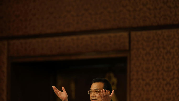 Chinese Premier Li Keqiang delivers a speech at an event organized by Indian Council of World Affairs (ICWA), in New Delhi, India, Tuesday, May 21, 2013. Keqiang is on a three-day visit to India to discuss bilateral and trade ties. (AP Photo/ Saurabh Das)