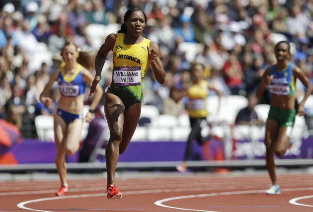 Jamaica's Novlene Williams-Mills, front, starts a women's 400-meter heat at the 2012 Summer Olympics in London Friday, Aug. 3, 2012. (AP Photo/Ben Curtis)