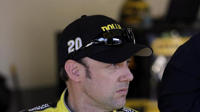 Matt Kenseth looks over the damage to his car in his garage after he was involved in a crash during practice for the NASCAR Sprint Unlimited Shootout auto race at Daytona International Speedway, Friday, Feb. 15, 2013, in Daytona Beach, Fla. (AP Photo/John Raoux)