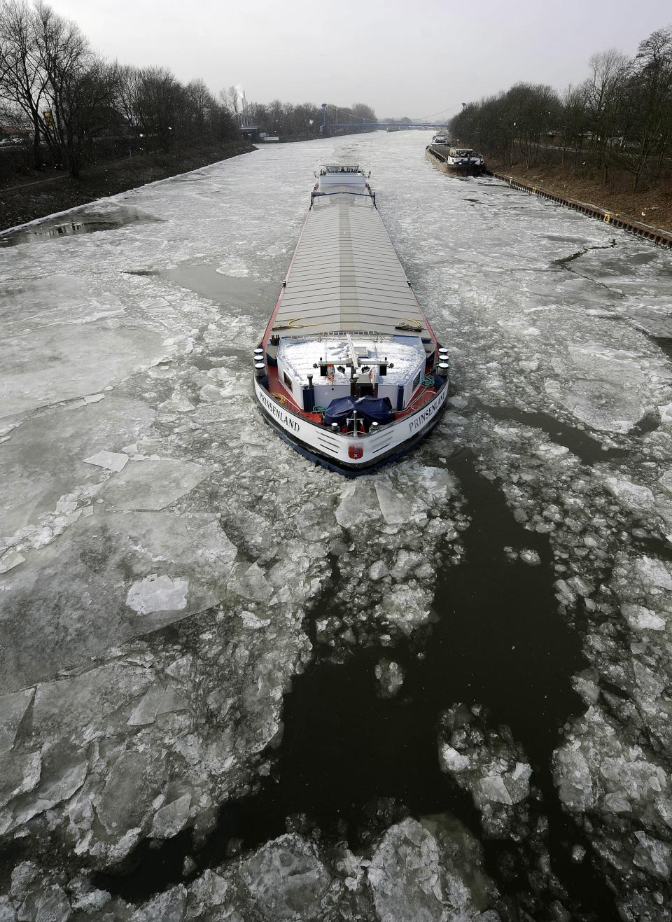 A transport ship makes its way through the ice on the Rhine-Herne canal in Gelsenkirchen, Germany, Tuesday, Feb. 7, 2012. Many canals and rivers in Germany are closed because of the ice. (AP Photo/Martin Meissnerr)