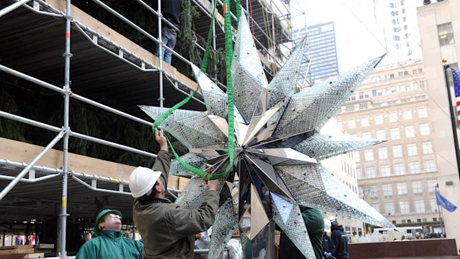 IMAGE DISTRIBUTED FOR SWAROVSKI - The 2012 Swarovski Star is prepared to sit atop the Rockefeller Center Christmas Tree, Tuesday, Nov. 20, 2012, in New York, and features 25,000 crystals and weighs 550 pounds.   Swarovski is the leading designer and producer of fashion jewelry and crystal decor objects. (Diane Bondareff/Invision for Swarovski/AP Images)