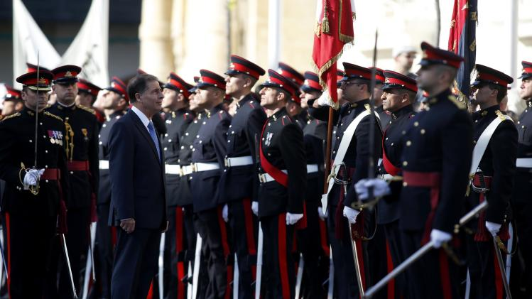 Malta's President Abela inspects an Armed Forces of Malta military parade to mark Malta's Republic Day in Valletta