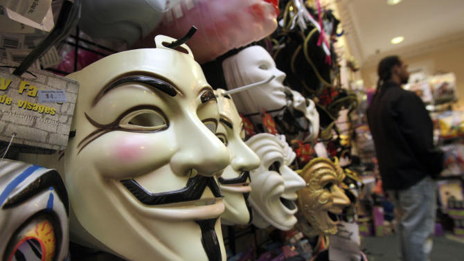 """FILE - In this Oct. 21, 2011 file photo, masks, including """"V for Vendetta,"""" left, are displayed at a Ricky's Halloween store in New York. Television audiences across China watched an anarchist antihero rebel against a totalitarian government and persuade the people to rule themselves. Soon the Internet was crackling with quotes of """"V for Vendetta's"""" famous line: """"People should not be afraid of their governments. Governments should be afraid of their people."""" The airing of the movie Friday night, Dec. 14, 2012 on China Central Television stunned viewers and raised hopes that China is loosening censorship. (AP Photo/Richard Drew, File)"""