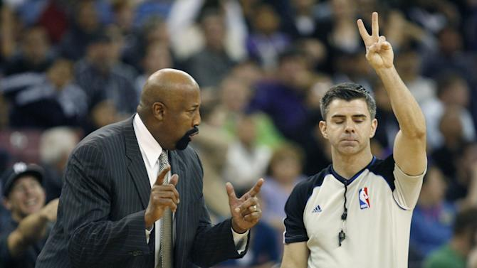 New York Knicks head coach Mike Woodson, left, questions official Eli Roe during the second half of an NBA basketball game against the Sacramento King in Sacramento, Calif., on Wednesday, March 26, 2014.The Knicks won 107-99