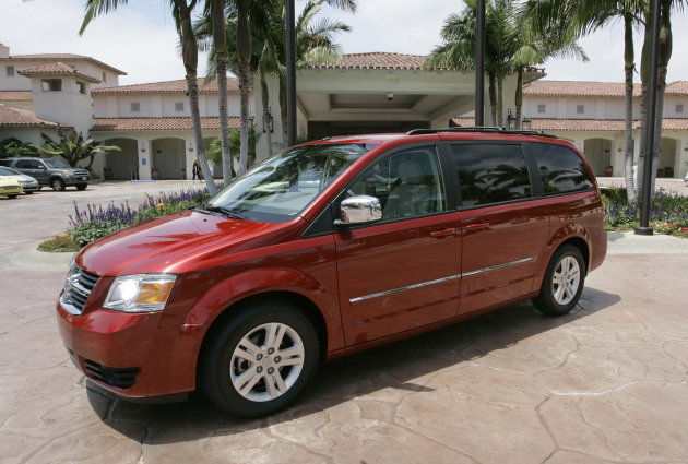 FILE - In this July 17, 2007 photo, the 2008 Dodge minivan is displayed at the Four Seasons Hotel in Carlsbad, Calif. Federal safety regulators have begun investigating Dodge and Chrysler minivans from the 2005 model year because the headlights can fail without warning. (AP Photo/Lenny Ignelzi, File)