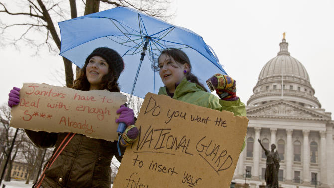 Jane Moran, left, 14, and Emma Rankin-Utevsky, 14, protest outside of at the State Capitol in Madison, Wis., Sunday, Feb. 20, 2011. Opponents to the governor's bill to eliminate collective bargaining rights for many state workers are on their sixth day of protesting. (AP Photo/Andy Manis)