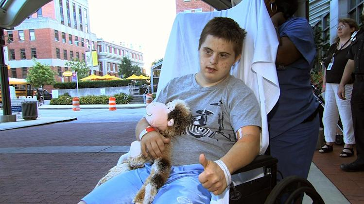 In this image from video, Daniel Borowy leaves the hospital in Baltimore, Monday, Sept. 10, 2012, to head home for the first time since being critically injured after he was shot by a classmate at a suburban Baltimore school on Aug. 27. (AP Photo/Rick Gentilo)