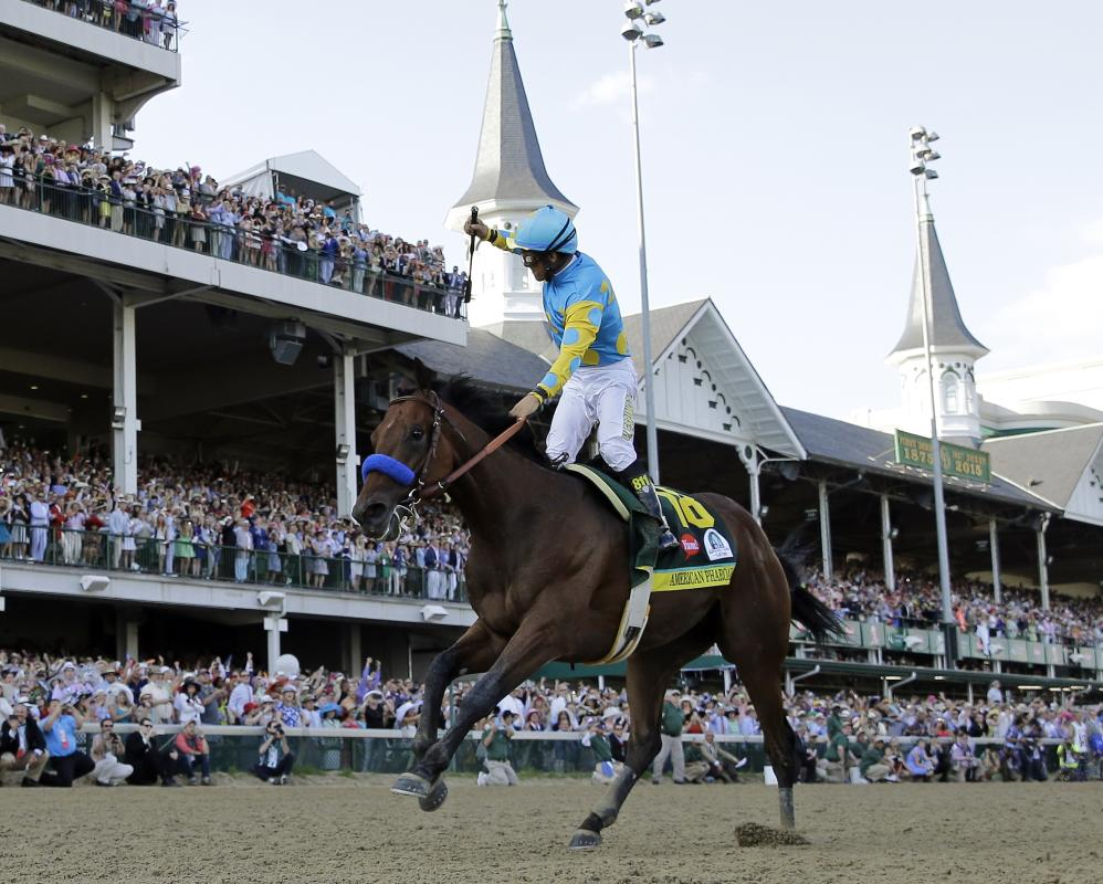 FILE - In this May 2, 2015 file photo, Victor Espinoza rides American Pharoah to victory in the 141st running of the Kentucky Derby horse race at Churchill Downs in Louisville, Ky. Last June, Espinoza was aboard California Chrome during his Triple Crown run that ended with a fourth-place finish in the Belmont. In 2002, he and trainer Bob Baffert teamed up with War Emblem to win the Kentucky Derby and Preakness before their Triple try ended when the colt stumbled out of the starting gate in the Belmont and finished eighth. Now, Espinoza and Baffert are back again with a colt many believed is poised to become the 12th Triple Crown winner and first since Affirmed in 1978. (AP Photo/David J. Phillip, File)