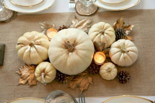 Glitter Ghost Pumpkin Centerpiece: And finally, who says pumpkins are just for Halloween? Not us! These ghost pumpkins are made a little more festive with a touch of glitter here and there. Love the sparkle.