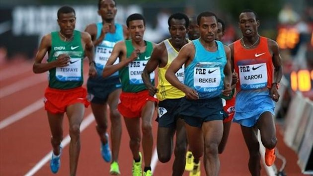 Kenenisa Bekele of Kenya leads a pack during the Men's 10,000m during day 1 of the IAAF Diamond League Prefontaine Classic (Getty Images)