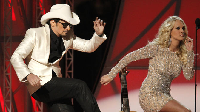 Hosts Brad Paisley and Carrie Underwood dance at the 46th Country Music Association Awards in Nashville