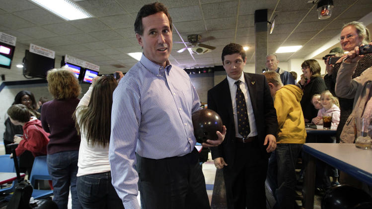 Republican presidential candidate, former Pennsylvania Sen. Rick Santorum chats with a supporter as he gets ready to bowl in Chilton, Wis., Sunday, April 1, 2012. Santorum outlined plans to leave Wisconsin the day before the state's contest Tuesday, an indication that the conservative favorite may be in retreat, his chances to stop Romney rapidly dwindling.  (AP Photo/Jae C. Hong)
