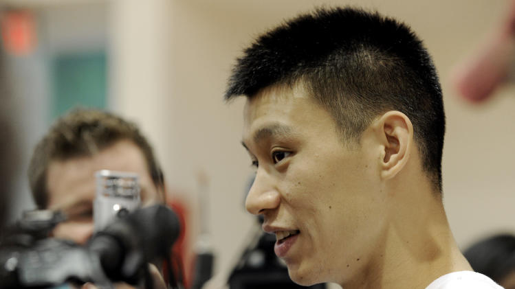 Houston Rockets' Jeremy Lin speaks with the media after NBA basketball practice, Tuesday, Sept. 18, 2012, in Houston. (AP Photo/Pat Sullivan)