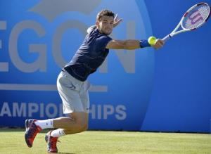 Bulgaria's Dimitrov returns the ball during his men's singles tennis match victory over Britain's Ward at the Queen's Club tournament in London