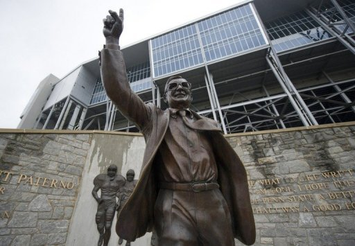 <p>The statue of former Penn State University football coach Joe Paterno outside Beaver Stadium. Workers at the university on Sunday used jackhammers and a forklift to remove the statue after Paterno was tarnished by a child sex scandal that saw his top aide imprisoned.</p>