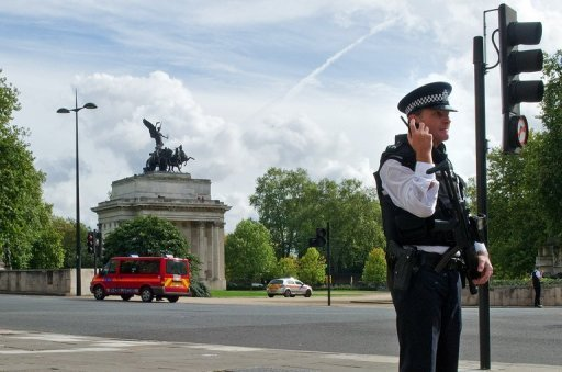 <p>File image shoqs a police standing guard near Hyde Park Corner, during a security alert in central London. The Arab Spring uprisings have given Al-Qaeda new arenas in which to rebuild, increasing the chances of home-grown terrorist attacks in Britain, the head of its domestic intelligence agency has warned</p>