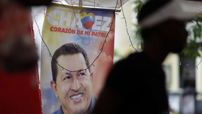 "An election poster of Venezuela's President Hugo Chavez is displayed at a state-run market in Caracas, Venezuela, Monday, Dec. 31, 2012.  Chavez is confronting ""new complications"" due to a respiratory infection nearly three weeks after undergoing cancer surgery, his Vice President Nicolas Maduro said Sunday evening in Cuba as he visited the ailing leader for the first time since his operation. (AP Photo/Ariana Cubillos)"