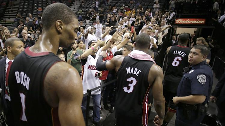 Miami Heat's Chris Bosh (1), Dwyane Wade (3), and LeBron James (6) leave the floor after defeating San Antonio Spurs at Game 4 of the NBA Finals basketball series, Thursday, June 13, 2013, in San Antonio. The Heat won 109-93. (AP Photo/Eric Gay)