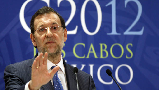 Spain's Prime Minister Mariano Rajoy gestures as he sepaks to the press during the G20 summit in Los Cabos, Mexico, Tuesday, June 19, 2012. (AP Photo/Eduardo Verdugo)
