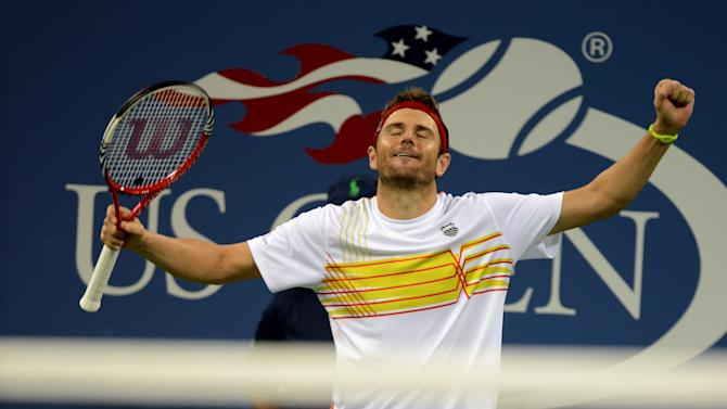 Mardy Fish celebrates his victory over Gilles Simon of France in the third round of play at the 2012 US Open tennis tournament, Saturday, Sept. 1, 2012, in New York. (AP Photo/Henny Ray Abrams)