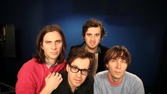 "This Feb. 19, 2013 photo shows members of the band Phoenix, from left, Deck D'arcy, Laurent Brancowitz, Christian Mazzalai and Thomas Mars, posing in New York. Phoenix frontman Thomas Mars said their new album, ""Bankrupt!,"" was born out of the negative influences going on in the band after the unprecedented success of their Grammy-winning 2009 album, ""Wolfgang Amadeus Phoenix."" (AP Photo/John Carucci)"