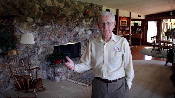 "FILE - In this June 21, 2006 file photo, cartoonist Bil Keane, creator of the comic strip ""Family Circus,"" poses in his home in Paradise Valley, Ariz. A spokeswoman for King Features Syndicate, the comic strip's distributor, says Keane died Tuesday, Nov. 8, 2011.  He was 89. (AP Photo/East Valley Tribune, Paul O'Neill) MAGS OUT, NO SALES, MANDATORY CREDIT"