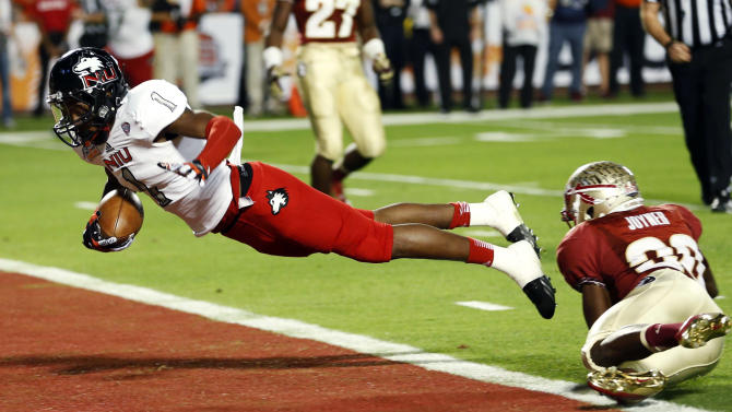 Northern Illinois wide receiver Martel Moore (1) leaps into the end zone after escaping from the grasp of Florida State defensive back Lamarcus Joyner (20) during the second half of the Orange Bowl NCAA college football game, Tuesday, Jan. 1, 2013, in Miami. (AP Photo/Alan Diaz)