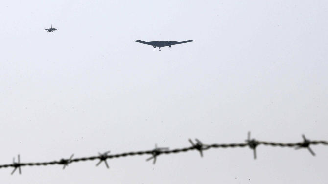 U.S. Air Force B-2 stealth bomber, center, flies over near the Osan U.S. Air Base in Pyeongtaek, south of Seoul, South Korea, Thursday, March 28, 2013. A day after shutting down a key military hotline, Pyongyang instead used indirect communications with Seoul to allow South Koreans to cross the heavily armed border and work at a factory complex that is the last major symbol of inter-Korean cooperation. (AP Photo/Shin Young-keun, Yonhap) KOREA OUT