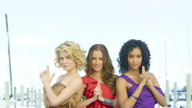 "In this undated image released by ABC, from left, Rachael Taylor, as Abby Sampson, Minka Kelly, as Eve, and Annie Ilonzeh, as Kate Prince, are shown from the ABC series, ""Charlie's Angels."" The action series, which focused on three female detectives in Miami, has struggled in the ratings since its premiere last month. It's ABC's first cancellation of the new fall season.  (AP Photo/ABC, Bob D'Amico)"