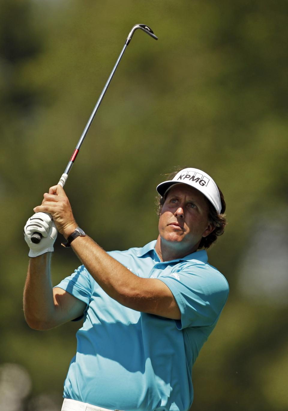 Phil Mickelson watches his shot on the first fairway during the pro-am of the Wells Fargo Championship golf tournament at Quail Hollow Club in Charlotte, N.C., Wednesday, May 2, 2012. (AP Photo/Chuck Burton)