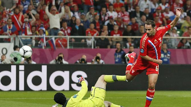 Russia's Roman Shirokov scores over Czech goalkeeper Petr Cech during the Euro 2012 soccer championship Group A match between Russia and Czech Republic in Wroclaw, Poland, Friday, June 8, 2012. (AP Photo/Jon Super)