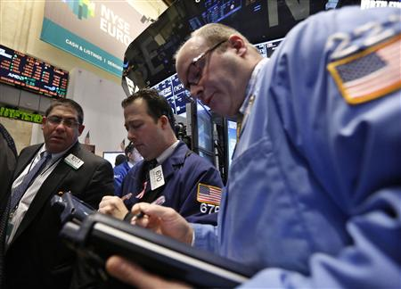 Traders work on the floor at the New York Stock Exchange, March 25, 2013. REUTERS/Brendan McDermid