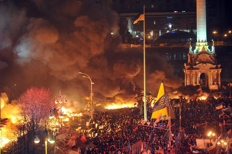 Anti-government protesters clash with the police during their storming of the Independence Square in Kiev on February 18, 2014