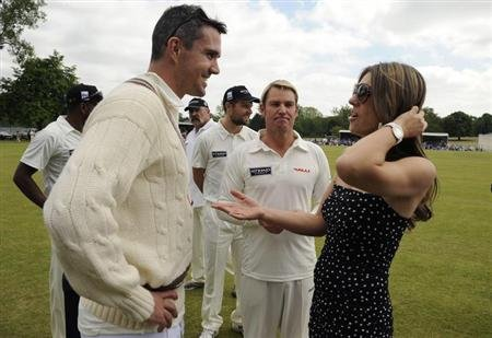 British actress Elizabeth Hurley (R) chats with England's Kevin Pietersen as Hurley's fiance, former Australian cricket player Shane Warne (2nd R), looks on before an England and Australia charity mat