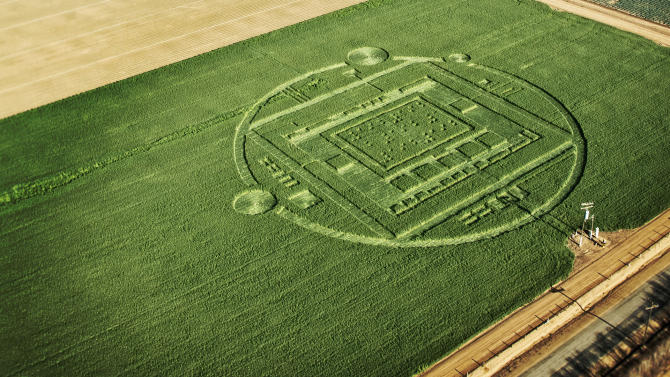 "This photo provided by Nvidia shows a 310-foot ""crop circle"" in a California barley field that mystified locals this week was explained Sunday Jan. 6, 2014: it was a publicity stunt by Nvidia Corp., a maker of chips for PCs and smartphones. The crop circle near Chualar, Calif., contained a stylized image of a computer chip and the number ""192"" in Braille. On Sunday, the company announced the Tegra K1, a new chip for tablets and smartphones that contains 192 computing ""cores,"" or mini-computers, for graphics applications. (AP Photo/NVIDIA)"