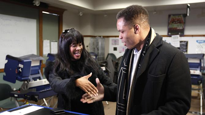 "FILE - In this March 9, 2012 file photo, then-U.S. Rep. Jesse Jackson Jr.,and his wife, Chicago Alderman Sandi Jackson, ask each other for their support and votes as they arrive at a polling station for early voting in Chicago.  Alderman Sandi Jackson on Friday, Jan. 11, 2013 announced she is resigning from the Chicago City Council. In a letter to Mayor Rahm Emanuel, she said that she could not adequately represent her district ""while dealing with very painful family health matters."" Rep. Jackson recently resigned from Congress while being treated for bipolar disorder and other medical issues. (AP Photo/M. Spencer Green, File)"
