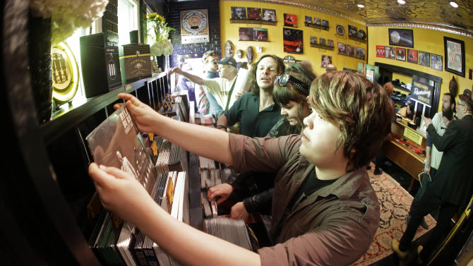 Connor Muddiman, 15, from Cincinnati, looks through albums on Record Store Day at Jack White's Third Man Records on Saturday, April 18, 2015, in Nashville, Tenn. (AP Photo/Mark Humphrey)