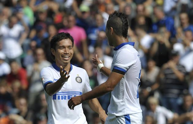 Inter Milan's Saphir Taider of Algeria, right, celebrates with his teammate Juto Nagatomo, of Japan, after scoring a goal during their Serie A soccer match against Sassuolo, at Reggio Emilia's Mapei s