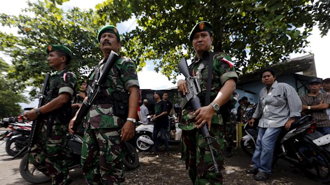 Indonesian soldiers stand as guard at Wijayapura port near the prison island of Nusa Kambangan in Cilacap