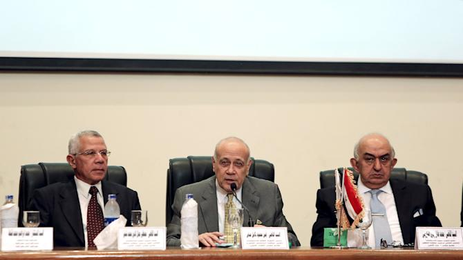 Ayman Abbas, head of the High Election Committee, speaks during a news conference in Cairo, Egypt