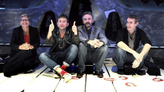 """From left to right, Chief Executive of the ENO Loretta Tomasi, musician Damon Albarn, artistic directors of the ENO John Berry and Rufus Norris during a press conference for Undress for the Opera, at the Coliseum Theatre, in London, Wednesday, Oct. 3, 2012. A Python and the founder of Gorillaz are trying to help opera shed its stuffy image. Monty Python's Terry Gilliam and Blur and Gorillaz singer Damon Albarn are supporting English National Opera's plan to entice new audience members with the promise of casual clothes, cheap tickets and cocktails. The company hopes to attract more newcomers with its """"Undress for the Opera"""" initiative, which reassures operagoers that it's OK to show up in jeans. Albarn hopes perceptions of opera as stuffy and expensive will change. He said Wednesday that """"we're carrying into this century a lot of ideas that belong to a previous generation."""" (AP Photo/John Stillwell, PA) UNITED KINGDOM OUT"""