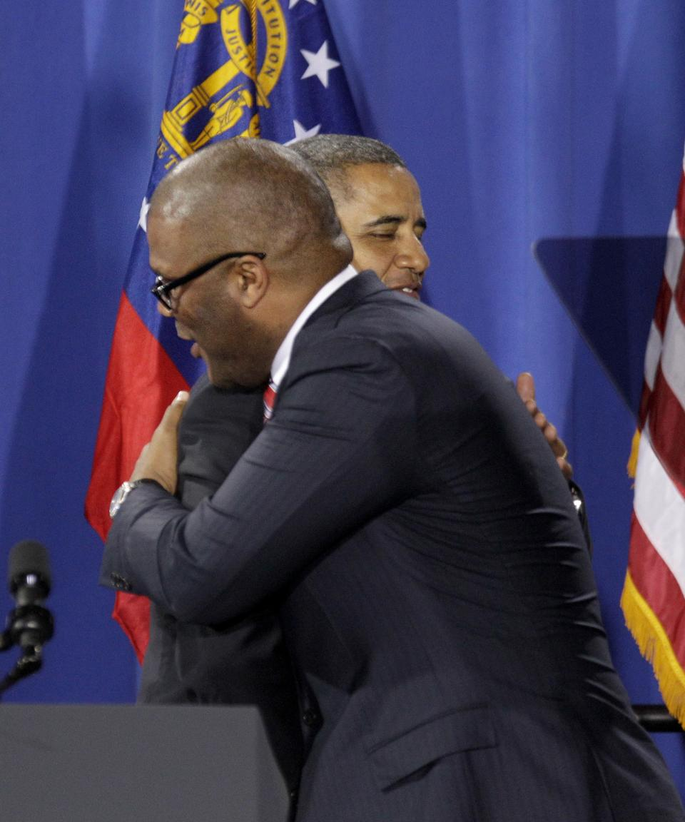 President Barack Obama, left, is introduced during a fundraiser by actor Tyler Perry Friday, March 16, 2012, in Atlanta. (AP Photo/David Goldman)