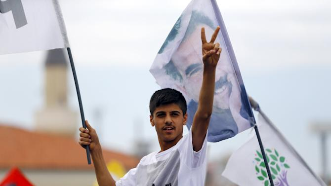 Supporter of Demirtas, co-chairman of the pro-Kurdish People's Democracy Party, gestures during an election rally for Turkey's June 7 parliamentary elections in Istanbul