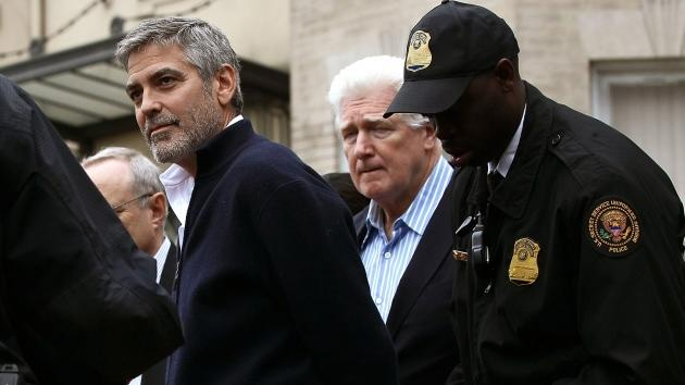 George Clooney is arrested during a demonstration outside the Embassy of Sudan on March 16, 2012 in Washington, D.C.  -- Getty Images